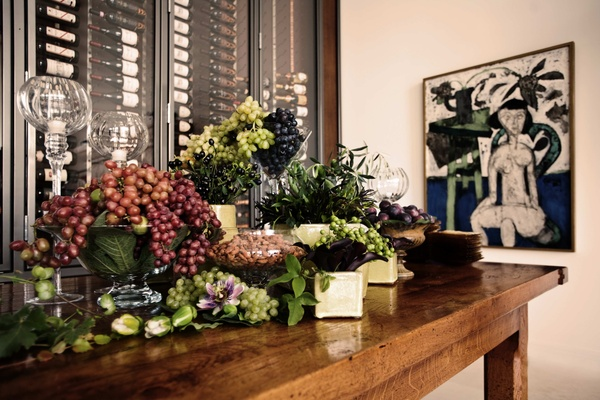 bunches of grapes in different colors arranged as table decor
