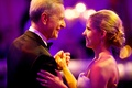 Bride in a strapless Vera Wang dress, updo, dances with father in a black tuxedo, bow tie
