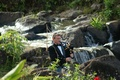 Bagpiper plays by a waterfall for a wedding in Hawaii