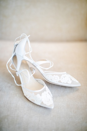 pointed toe bridal shoes with lace floral appliques and lace-up details