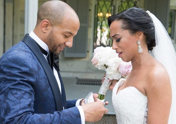 bride cries as groom opens jewelry box with diamond bracelet