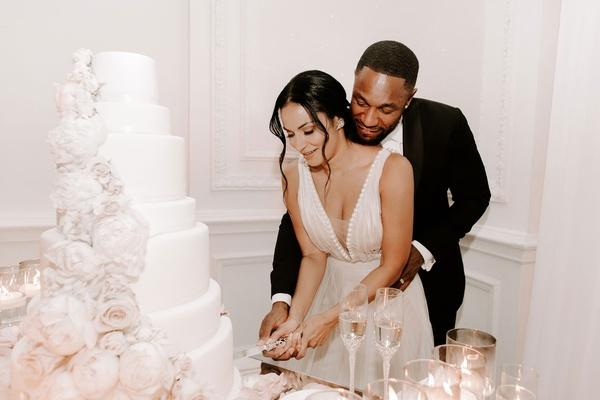 "r&b singer durrell ""tank"" babbs & zena foster wedding, cutting the cake, v-neck wedding dress"