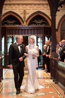 wedding processional bride in high neck pronovias wedding dress veil white bouquet father of bride