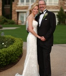 Bride in beaded sheath dress and groom in tuxedo