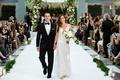 bride in pronovias v neck wedding dress white bouquet greenery groom in tuxedo walking up aisle