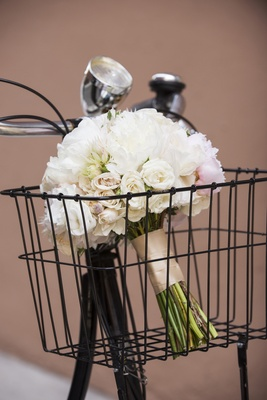 White bouquet in bike basket in New York City