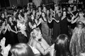 Black and white photo of wedding guests dancing