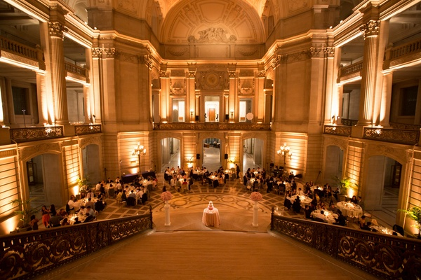 Reception in the rotunda of San Francisco City Hall with warm lighting