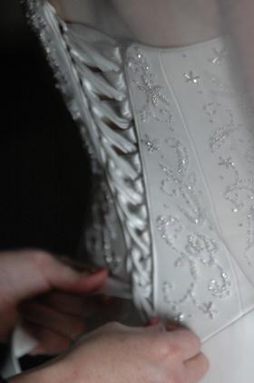 Corset style wedding dress with lace up ribbon back