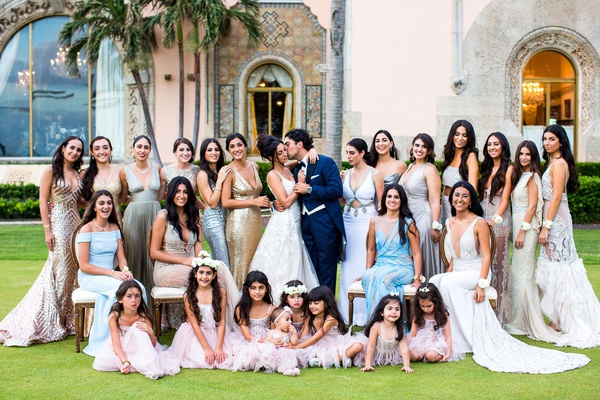 bride and groom with wedding party bridesmaids in mismatched dresses flower girls in pink mar a lago