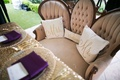 sweetheart table with personalized pillows on love seat with gold sequin table linen purple napkins