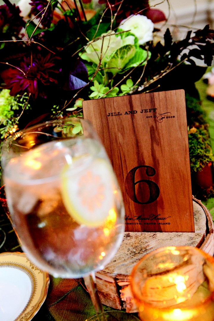 Whimsical wood table numbers at wedding reception