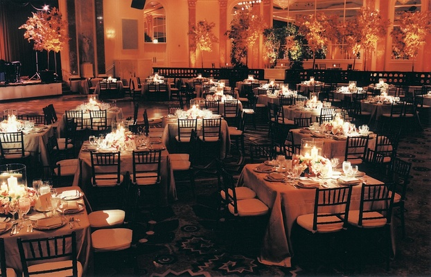 Ballroom of square tables and orange lighting