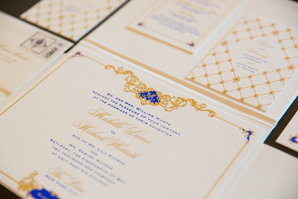 White cards with gold and royal blue letterin