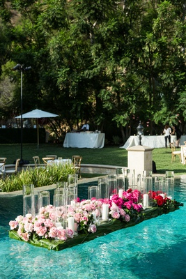wedding reception in backyard beverly hills home greenery pink rose flowers candles hurricane vases