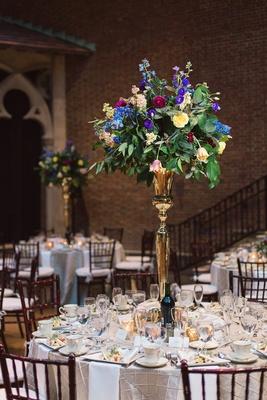 white tablescape silver details colorful centerpiece dayton ohio wedding reception shiny circle