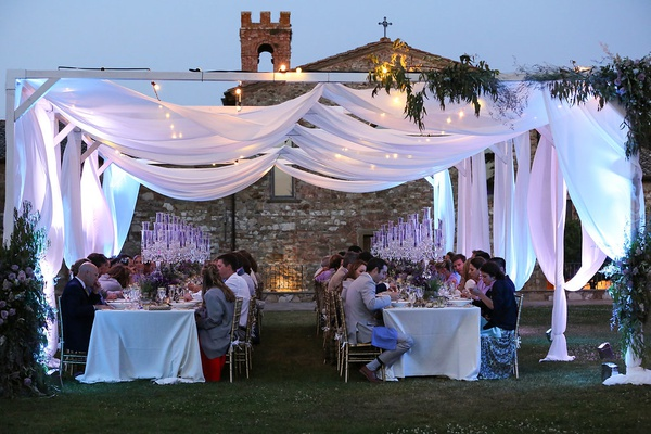destination wedding in tuscany, outdoor ceremony under drapery with soft lighting