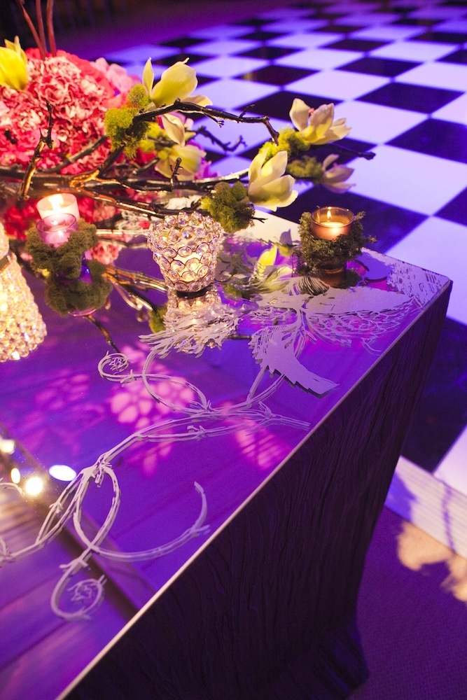 Mirror reception table with etched pattern and mossy candles