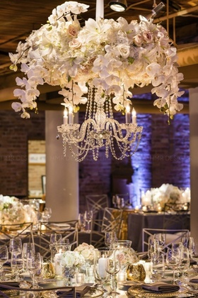 Floral chandeliers elevate the mood and create more table space below.
