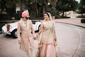 bride and groom for sikh ceremony with pastel outfits