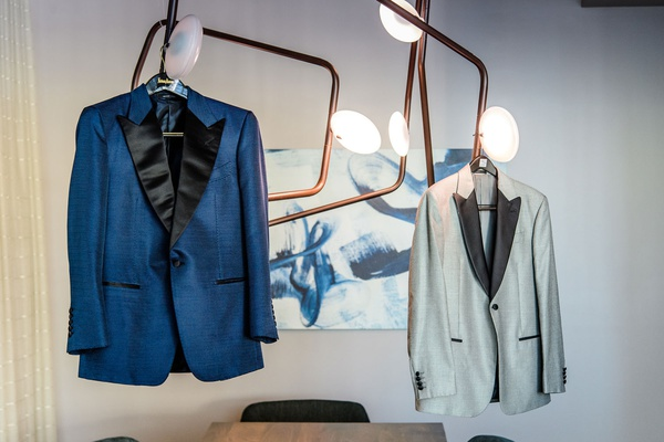 deep blue tuxedo jacket with black lapels, grey tuxedo jacket with black lapels, gay wedding outfits