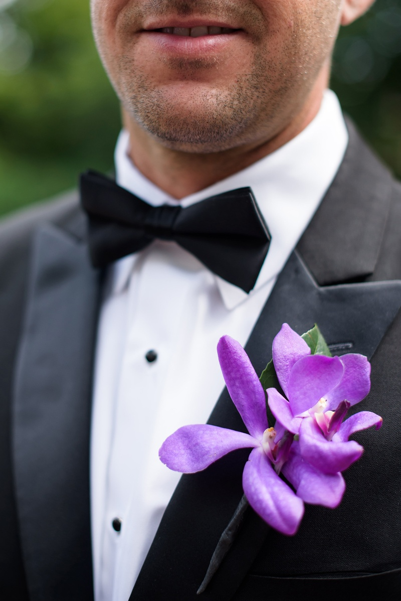 groomsman's boutonniere made with two purple orchids