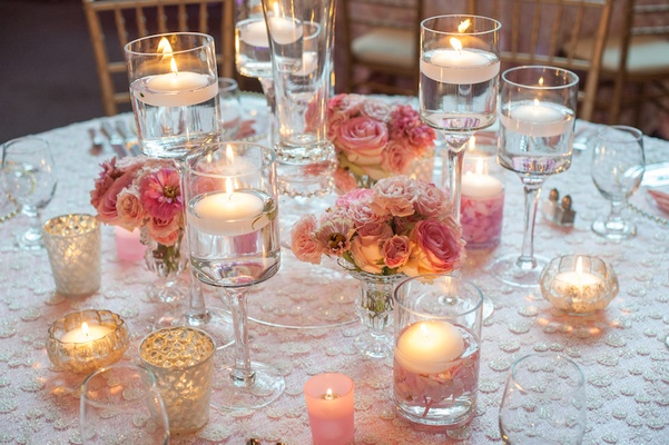 Roses and floating candles in Monet glass vases