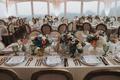 wedding reception french round back chair low centerpiece blue hydrangea orange rose anemone menu