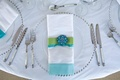 Silver beaded charger plates and blue linens