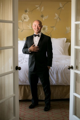 groom in giorgio armani tuxedo and rolex watch, asian american groom, bald groom