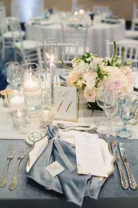 wedding reception steel blue velvet napkin and linen gold pink white greenery decor
