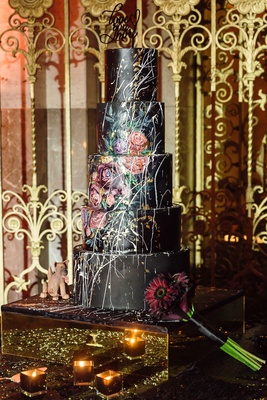 wedding cake designed by groom with cake designer hand painted flower details black contrast paint