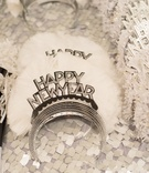 New Year's Eve party hats on sequin table