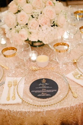 Navy blue round menu design with gold and white calligraphy monogram sequin tablecloth low flowers