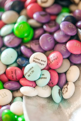 M & M candies with couple portrait and welcome notes