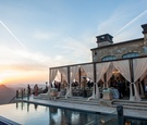 Malibu Rocky Oaks Vineyard reception overlooking the mountains with sheer drapery on terrace pool