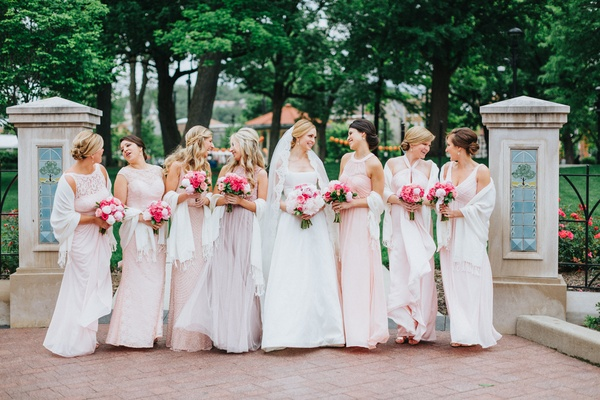 bride in custom a-line gown, bridesmaids in mismatched blush dresses, bridesmaids with pashminas