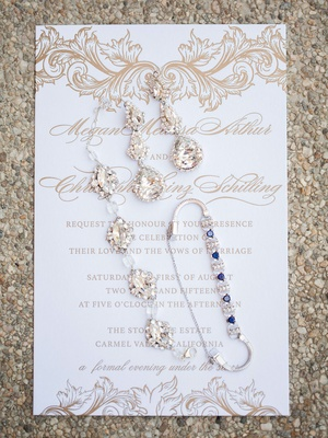 brides dangling earrings crystal bracelet and bracelet with blue gemstones on white gold invitation