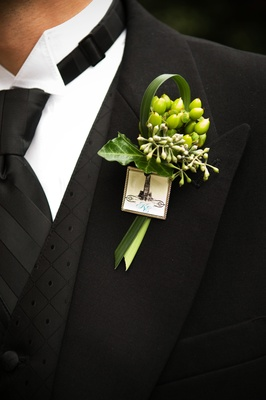 green ribbon and leaf boutonniere with duke charm