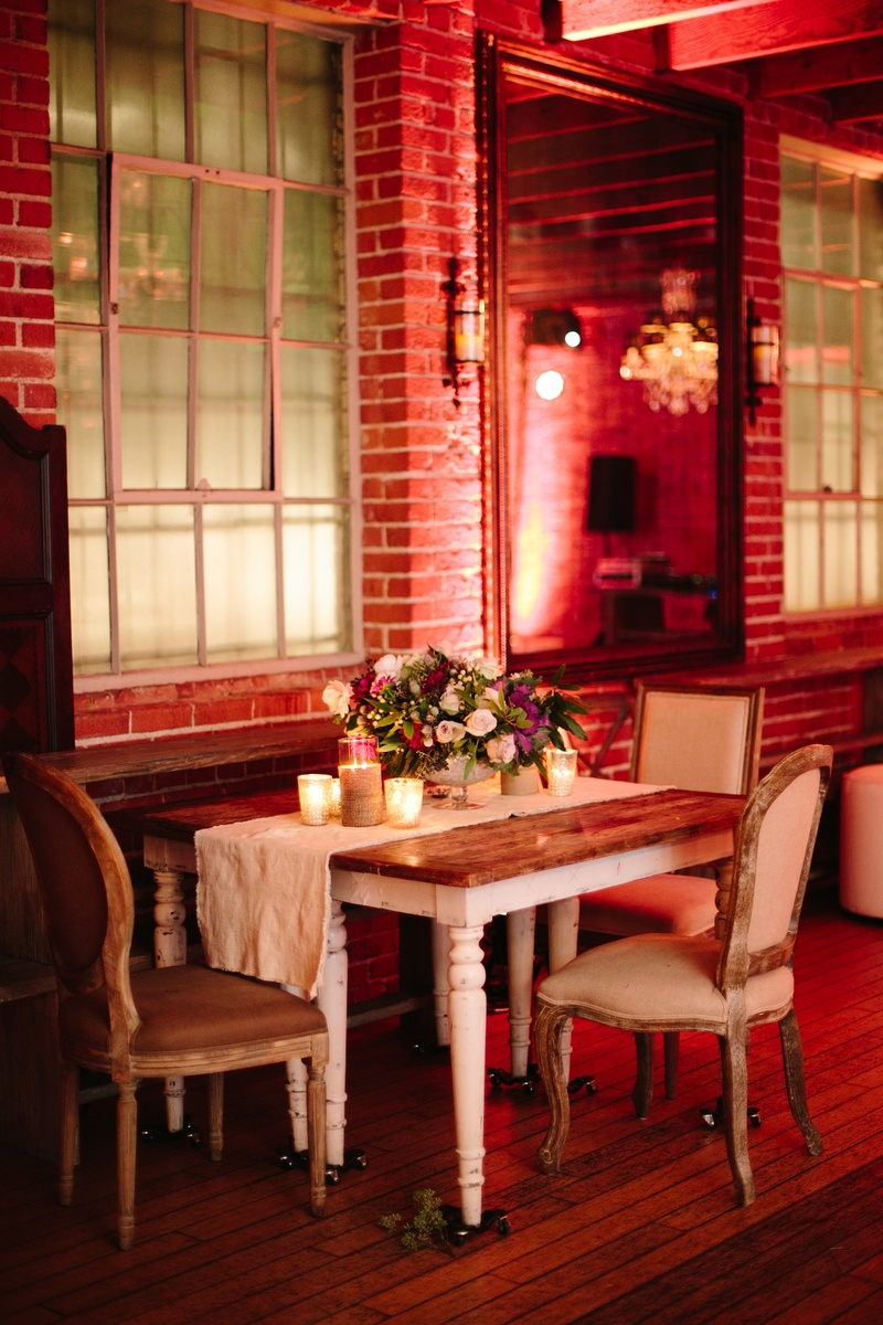 Shabby chic wedding table with plush chairs and runner