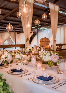 barn wedding reception u shape table gold terrarium geometric glass orb pendants pink dahlia flowers