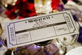 Shimmer silver wedding invite in shape of ticket
