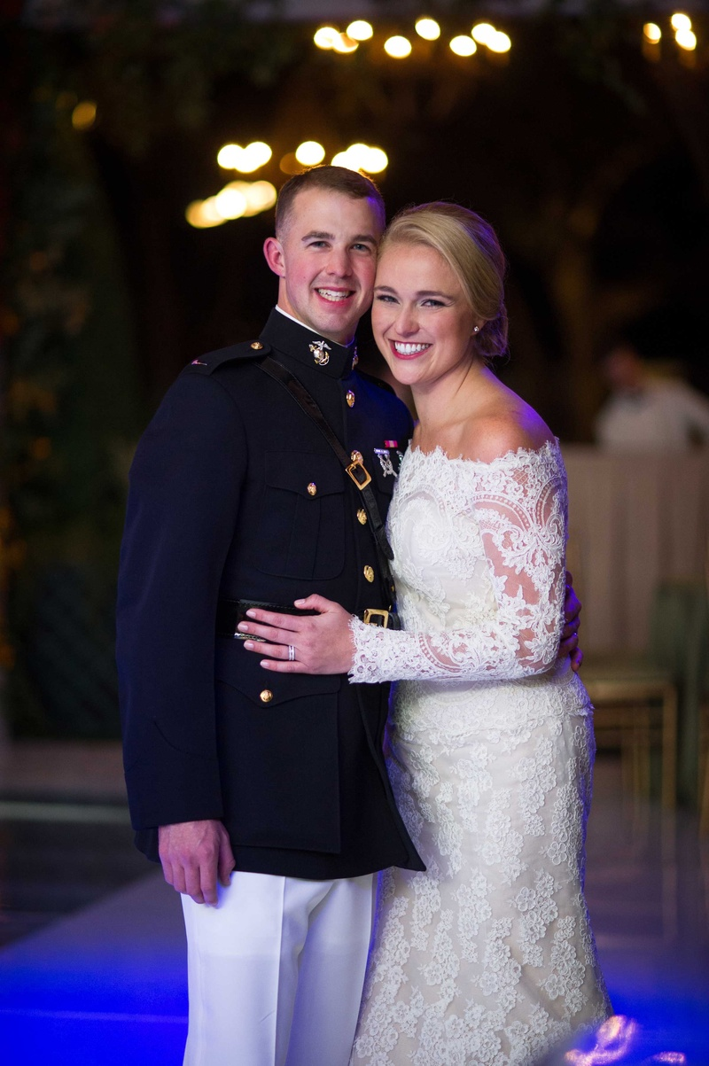 Bride in off the shoulder long sleeve Isabelle Armstrong wedding dress with military groom