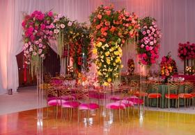 wedding reception pink velvet cushion with yellow orange pink flowers lucite arch arbor ballroom