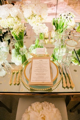 Wedding reception mirror top table gold flatware gold charger, white rose, peony, tulip, lily flower