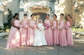 bridesmaids wearing strapless light pink gowns and carrying pink bouquets