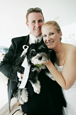 Black and white puppy with couple