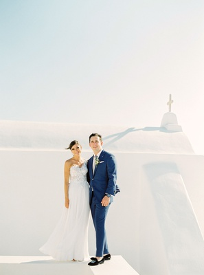 stephanie economides and brandon fay destination wedding in mykonos greece portrait white buildings