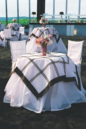 Cocktail hour tables with black and pink tablecloths
