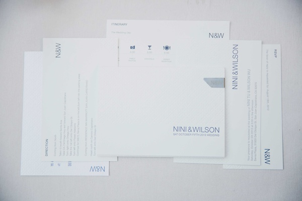 minimalist modern wedding invitations with white and blue lettering